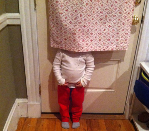 Kid behind a curtain