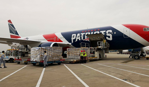 Plane with masks being unloaded