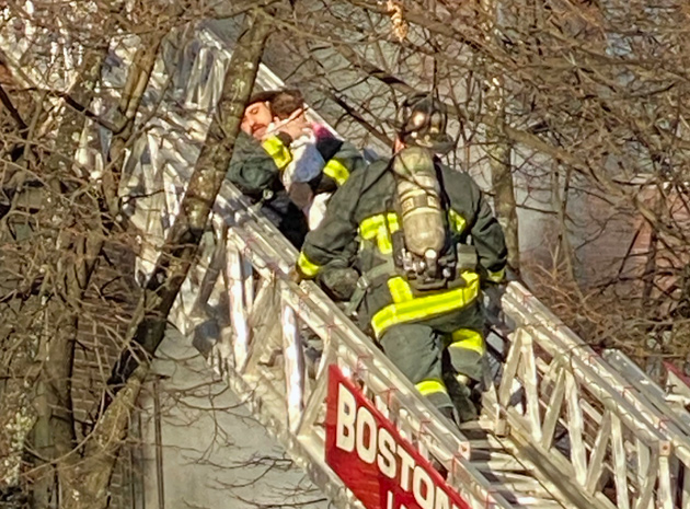 Firefighters from Ladder 4 rescue child at West Newton Street fire.