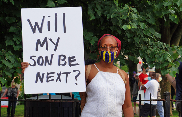 Woman with sign: Will my son be next?