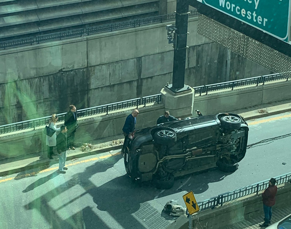 Car on its side at I-93 entrance near South Station