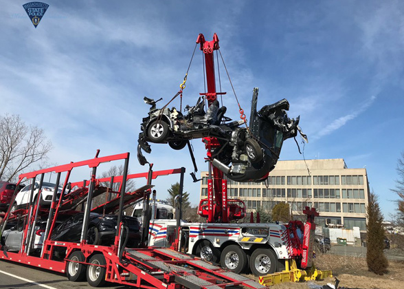 Remains of a vehicle removed from car carrier in Peabody