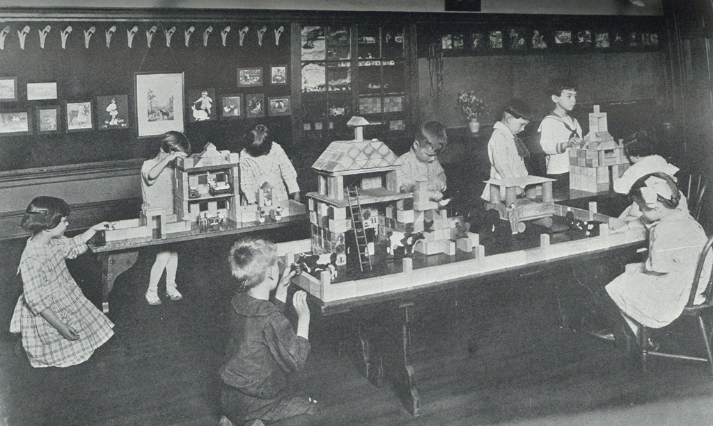 Kids at tables in old Boston