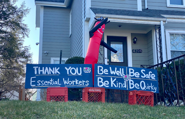 Waving tube guy in Roslindale wishes essential workers well