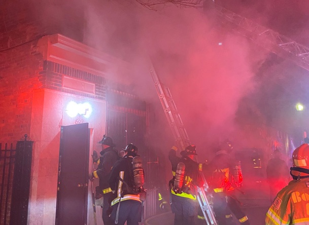 Firefighters, smoke at Dudley Street fire
