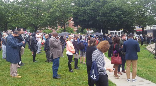 People at vigil for stabbed rabbi