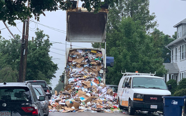 Recycling truck disgorging its contents in West Roxbury