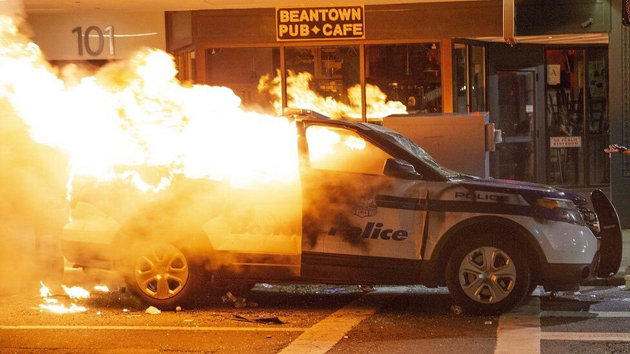 Boston Police cruiser on fire on Tremont Street.