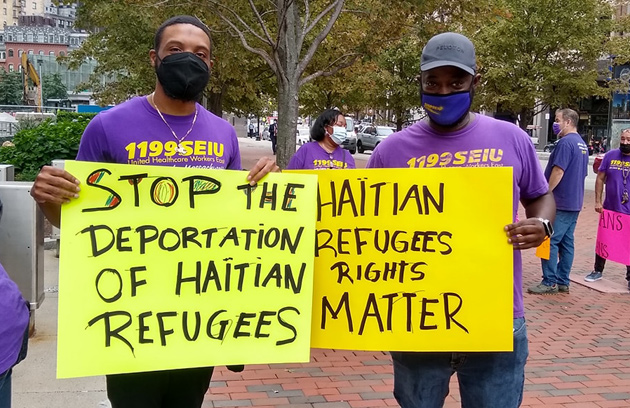 People demanding the end of Haitian deportation from Del Rio