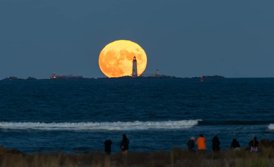 Harvest moon rises over the Five Sisters off Winthrop