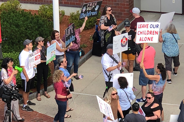 Protesters outside DESE meeting in Malden