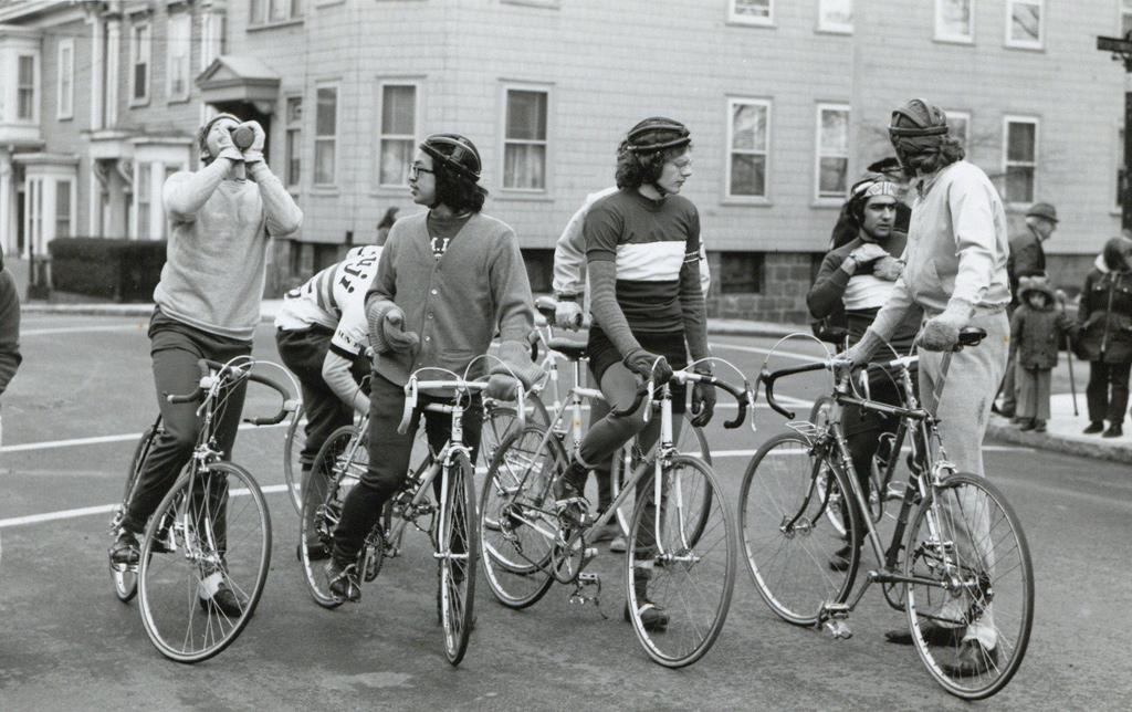 Guys on bikes in old Boston