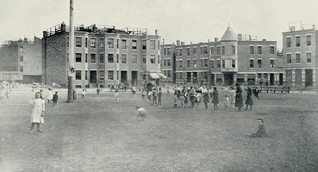 Kids on play field in old Boston