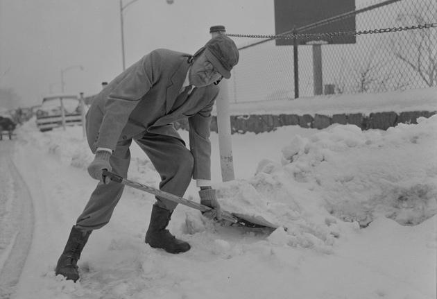 Paul Dudley White shoveling snow
