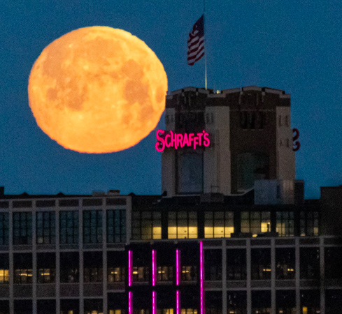 Moon sets over the Schrafft's Building in Charlestown