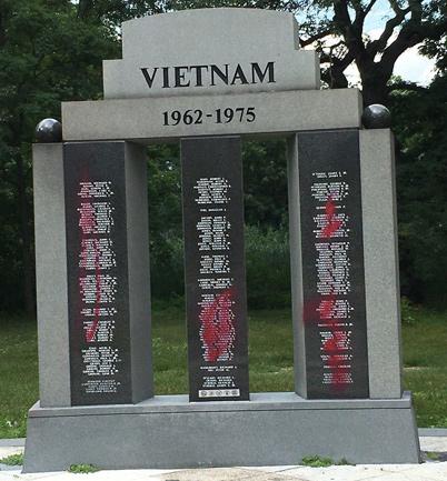 Defaced Vietnam memorial in the Rose Garden