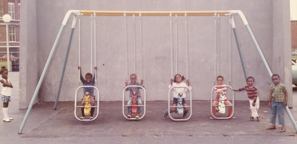 Kids on swings in old Boston