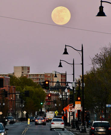 Full moon over Union Square in Somerville