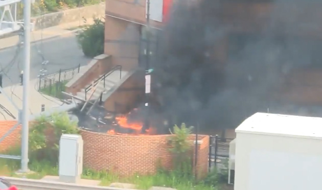 Downed transformer and pole on fire in Allston