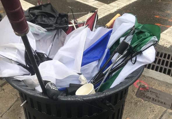 Umbrellas in the trash in Copley Square