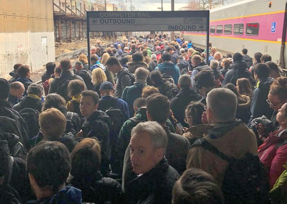 Crammed commuter-rail platform at Porter Square in Cambridge