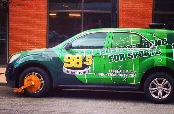 Booted Sports Hub car on Canal Street in Boston