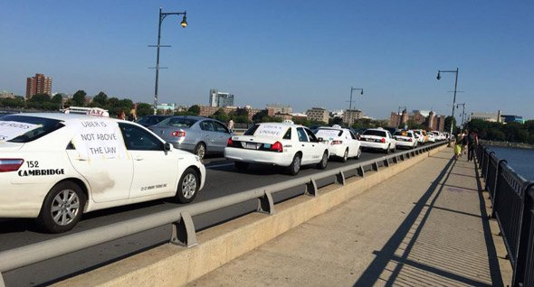 Taxi drivers protest Uber on the Massachusetts Avenue Bridge between Boston and Cambridge