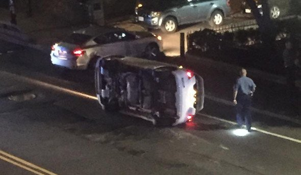Flipped car on Massachusetts Avenue in Boston