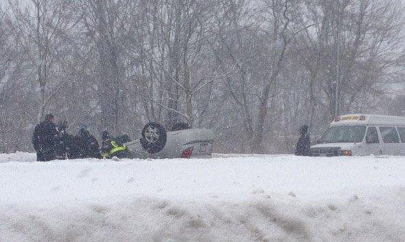 Car flips over on Alewife Brook Parkway
