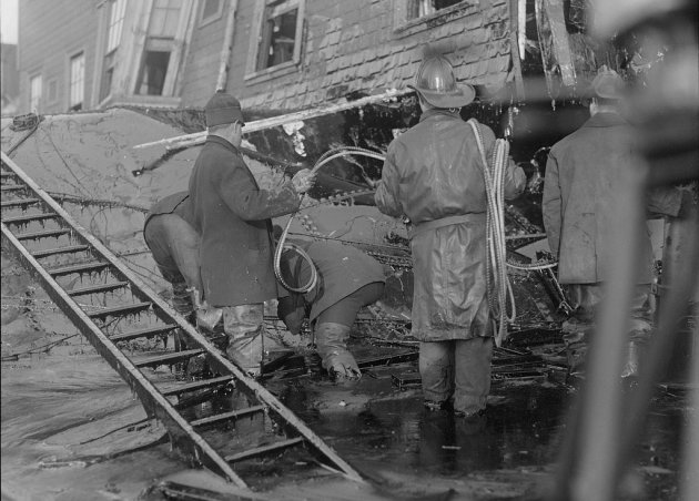 Firefighters knee deep in molasses in Boston