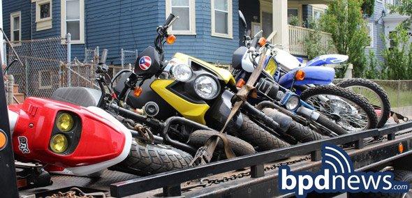 Dirt bikes being hauled away