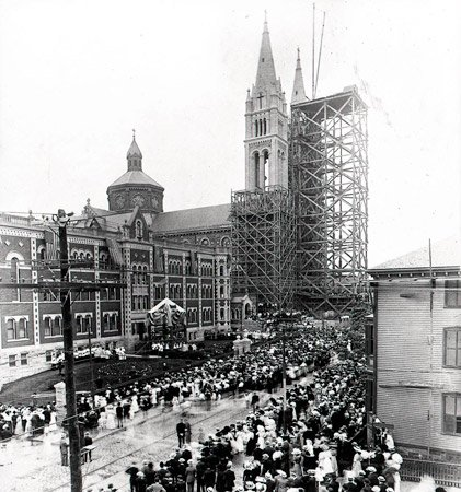 Church in old Boston with scaffolded steeples