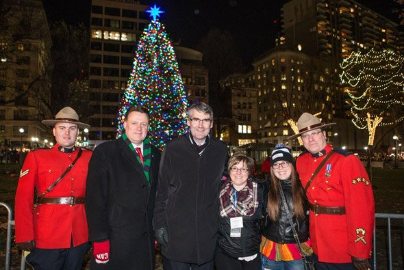 Canadians in front of the Boston Christmas tree, a gift from Nova Scotia