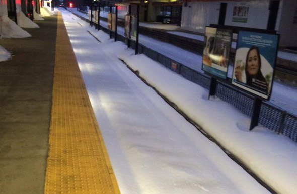 Fresh snow at Oak Grove on the Orange Line
