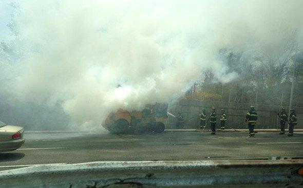 Street sweeper on fire in Belmont