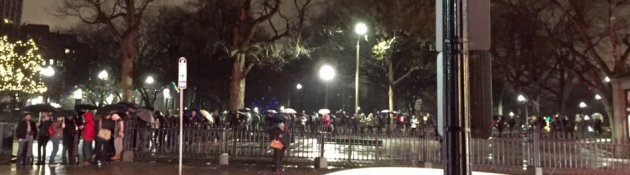 People waiting in the rain to see Star Wars in Boston