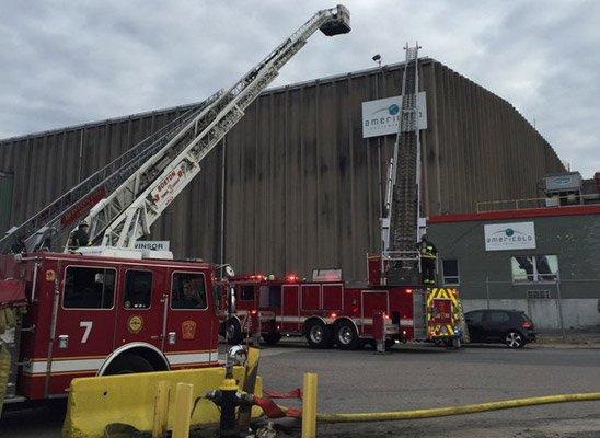 Firetrucks at 100 Widett Circle cold-storage fire