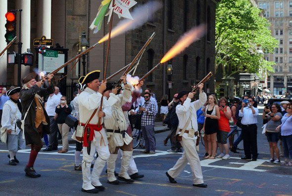 Minutemen fire muskets on Tremont Street