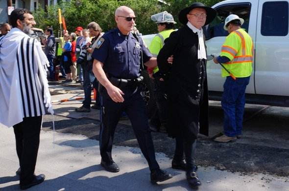 Rev. John Gibbons of the First Parish in Bedford - and chaplain for the town's Minutemen - under arrest.