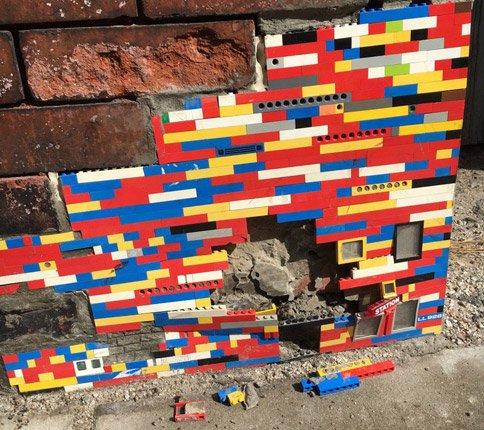 Damaged Lego wall in South Boston