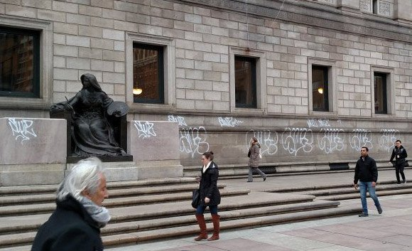 Graffitti on the front of the BPL in Copley Square