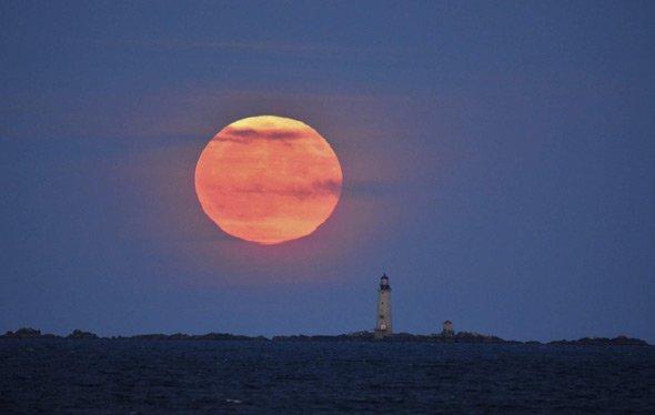 Harvest moon over Graves Light