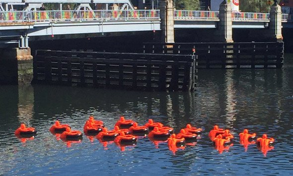 Orange people in Fort Point Channel