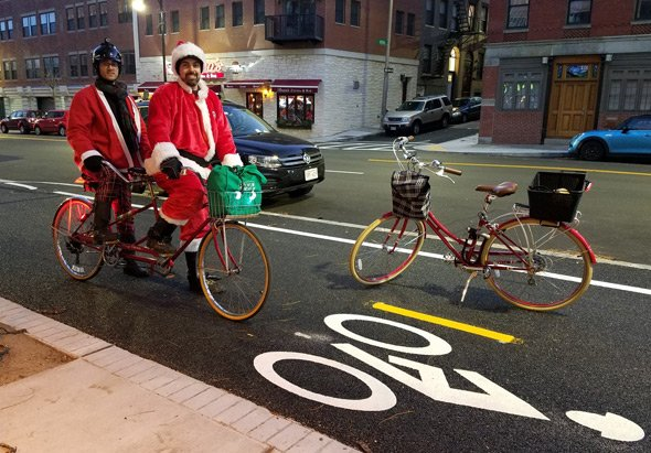Santas on a tandem bike in Boston's North End