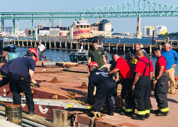 Man being rescued from barge