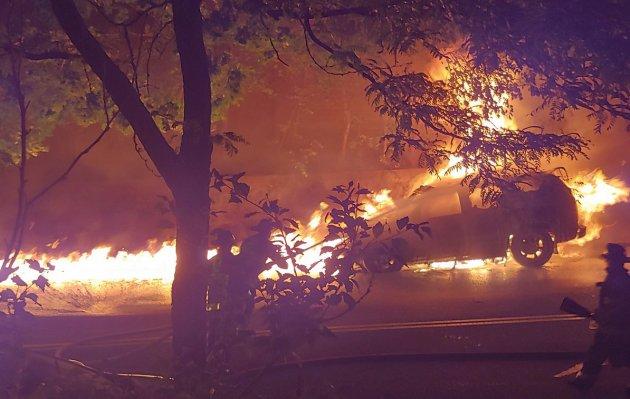 Burning car and street in Roslindale