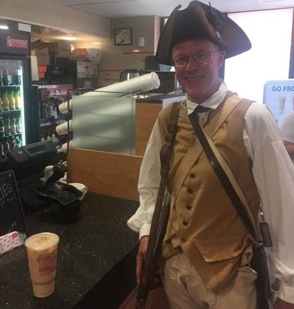 Minuteman picking up a Dunkin' Donuts iced coffee
