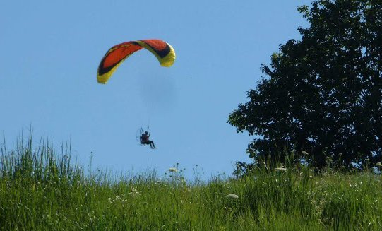 Paraglider with propeller at Millennium Park in West Roxbury