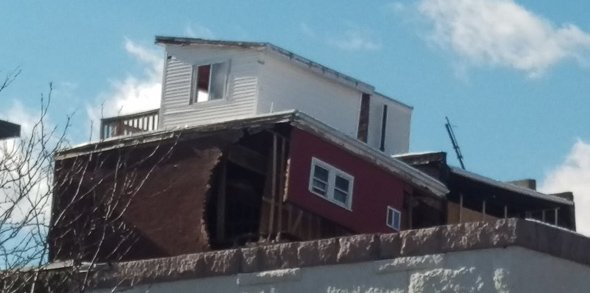Partially collapsed building.