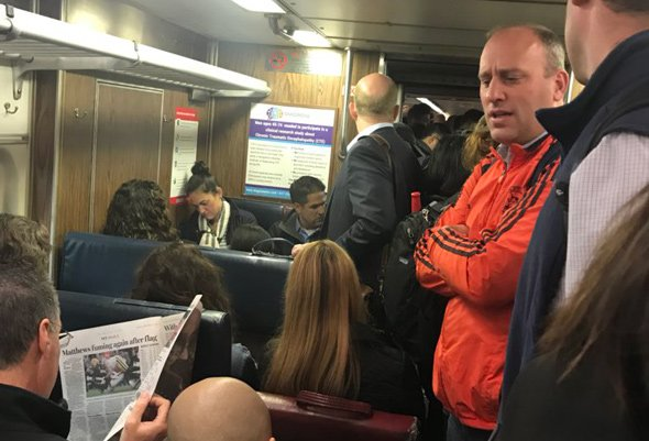Overcrowded train at Roslindale Village